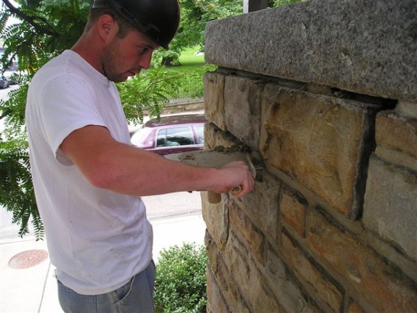 Cleaning of brick exterior and tuck pointing