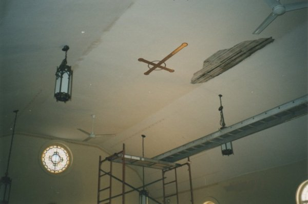 Severe water damage to ceiling, plaster ceiling on verge of collapse